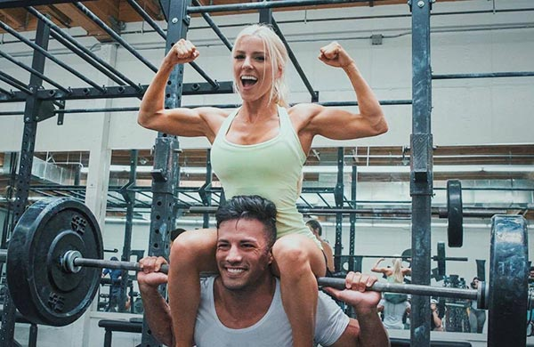 Christian Guzman and Heidi Sommers working out