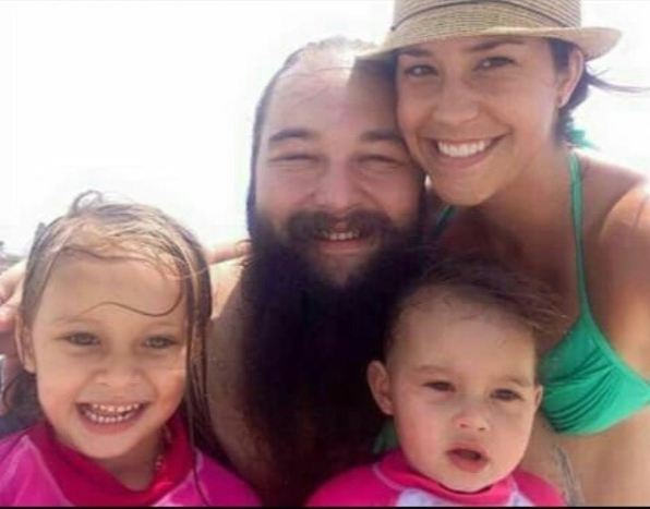 a perfcet selfi of WWE World Heavyweight champion Bray Wyatt with his perfcet family, such as wife and two children.