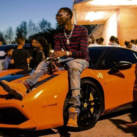Rich Young Dolph and bulletproof Car