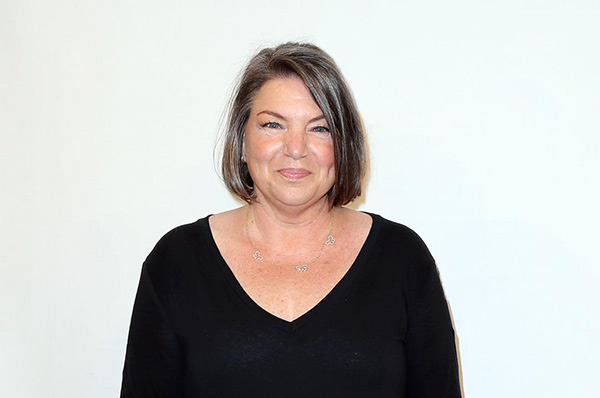 Cancer survivor: Mindy Cohn in black t-shirt