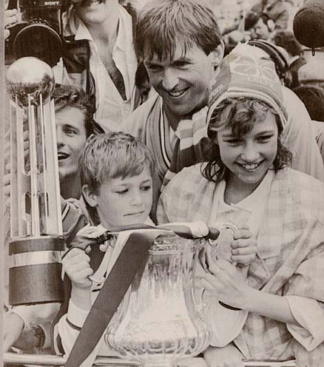 Kenny Cates hanging Trophies with Paul and Kelly at her younger age