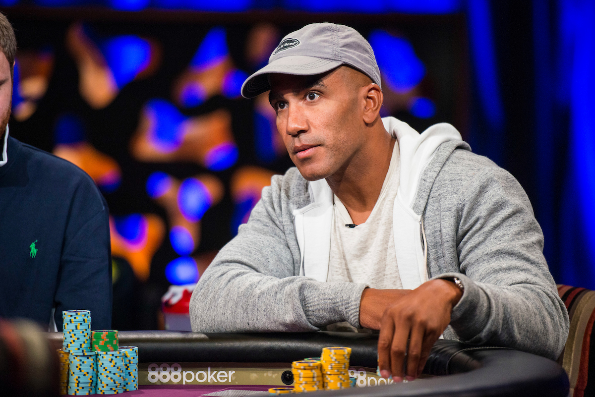 Bill Perkins is staring at someone at casino while playing poker.