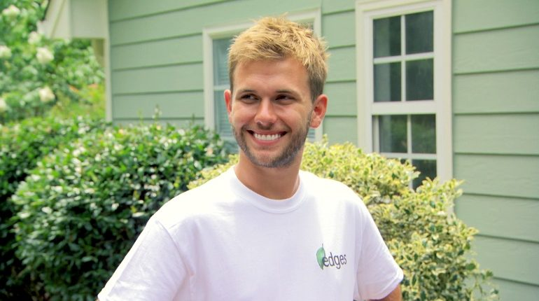 Chase Chrisley smiling and wearing white shirt
