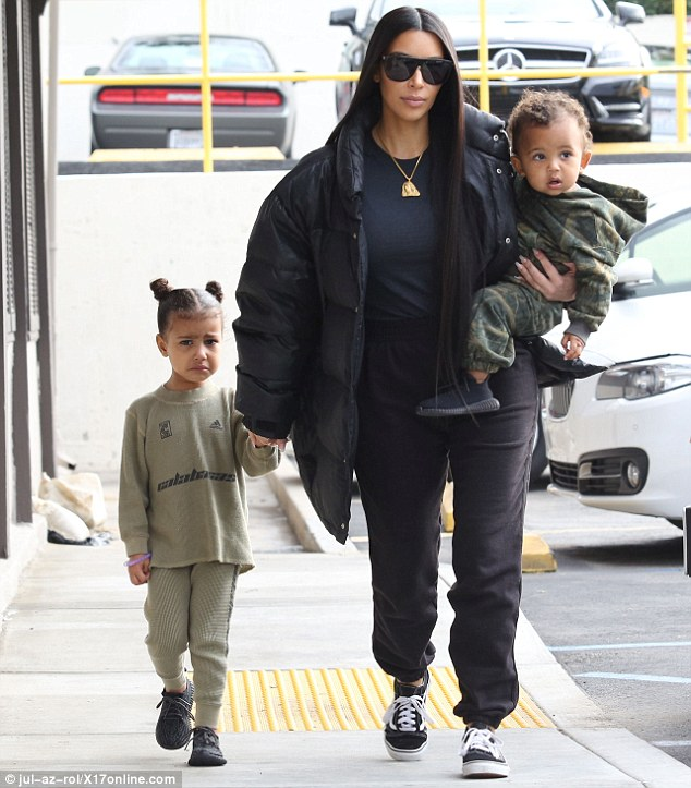 Kim Kardashian with daughter North and son Saint.