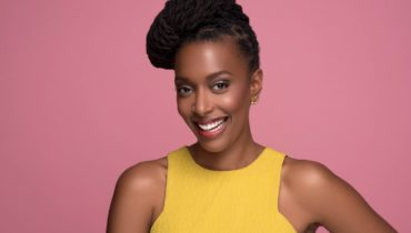 Franchesca Ramsey smiling at the camera wearing a yellow top.