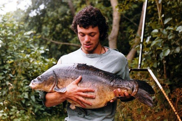 Young Jeremy Wade holding a giant fish.