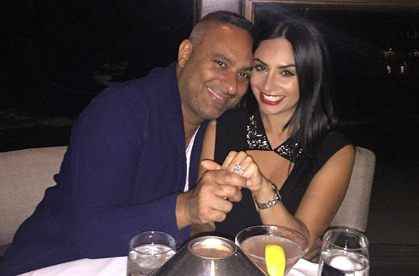 Russell Peters and Ruzanna Khetchian showing engagement ring